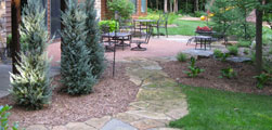 Flagstone pathways and water features dominate this Landscape Solutions design