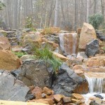 Large waterfalls contracted of a mix of gray and red large rock