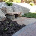 Rock bench integrated into hardscaping