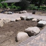 During installation placement of large boulders
